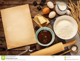 baking chocolate cake ingredients and blank paper background