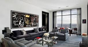 apartment living room furniture with beige and black sofa in