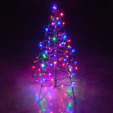 small tree with led lights and colored white decoration