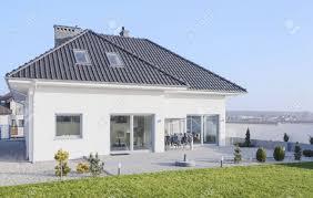 white modern bungalow designed in scandinavian style stock photo
