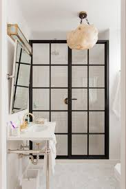 polished brass gooseneck shower head design ideas