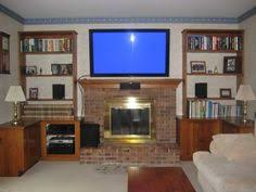 Tv Mount Over Fireplace by Is Your Tv Mounted Above A Fireplace Tv Room Pinterest