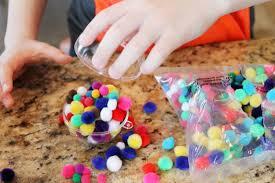 pom pom ornament craft for child at