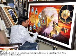 a painter islamabad april 27 u2013 a painter busy in giving final touches to a