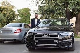 palm audi muhammad usman with audi and mercedes at royal palm golf and