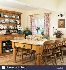 pine table and chairs and large pine dresser in country kitchen