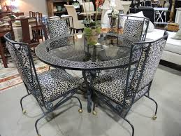 round black wrought iron table with glass top combined with black