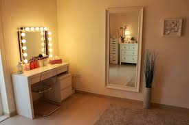 bathroom white wooden makeup table with lighted mirror plus
