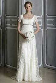 high waist wedding dress so pretty in this simple lace covered empire wedding dress by