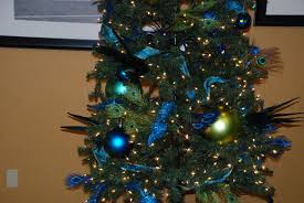 christmas tree decorated with feathers christmas lights decoration