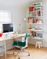 home office using modern furniture and wall mounted bookshelves