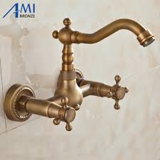 wall faucets kitchen aliexpress buy wall mounted antique brass faucets kitchen