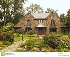 upscale family home with beautiful landscaping royalty free stock