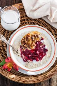 cranberry apple sauce thanksgiving christmas oats porridge with cranberry sauce apples and pecans