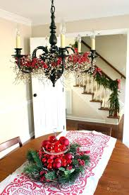 ornaments hanging from chandeliers add garland around