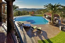 Backyard Cement Patio Ideas Stamped Concrete Patio Ideas Pool Tropical With Balcony Fence