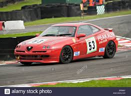 alfa romeo gtv alfashop alfa romeo gtv saloon racing car negotiates brittens at