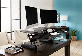 Stand Or Sit Desk by Sit Stand Options That Fit Your Desk And Your Budget Varidesk