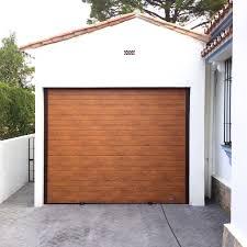 puertas de cocheras automaticas puertas de garaje en marbella venta instalaci祿n y reparaci祿n