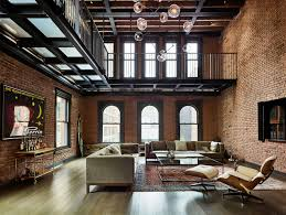 Brick Loft by Living Area With Lots Of Exposed Brick Sits Beneath A Metal