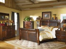Natural Pine Bedroom Furniture by Rustic Pine Bedroom Furniture Brown Shade Table Lamp On Wooden Bed