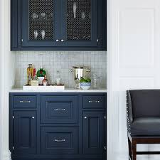 White And Blue Kitchen Cabinets White And Navy Blue Kitchen With White Glass Tiles Transitional