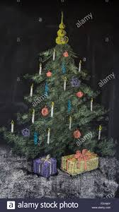 christmas tree sketch on a blackboard made with chalk stock photo