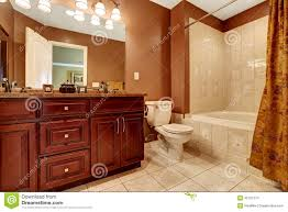 what color cabinets with beige tile bathroom in brown color with beige tile trim stock photo