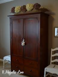 Palladia Wardrobe Armoire Select Cherry Finish Our New White Bed And Our Master Bedroom Armoire Wardrobe