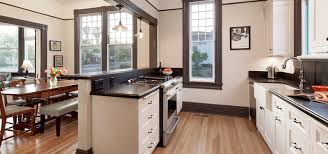 kitchen white galley kitchen with black appliances tray ceiling