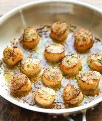 comment cuisiner les petoncles recettes de pétoncles grillés au beurre à l ail et citron