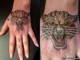 kesha tiger back of hand tattoo steal her style