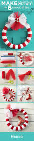 make a candy cane wreath in 6 simple steps first wrap the wreath