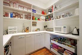 modern walk in pantry with pull out drawer and cabinets keep