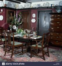 dark wood furniture in an aubergine painted nineties cottage