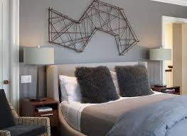 bedroom beige stripes wall upholstered headboard white cushions