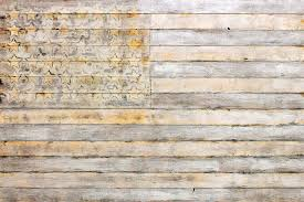 american flag on distressed wood beams white yellow gray and brown