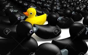 a non conformist depiction of a yellow rubber bath duck swimming