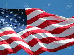 Waving American Flag Waving American Flag Against A Blue Sky Background Stock Photo