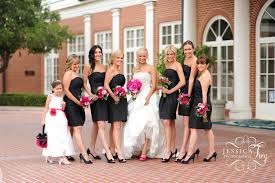 love the black dresses pink flowers and brides pink shoes a