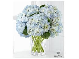 set a chic hanukkah table with joyful flowers by vera wang