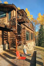 cool log homes outdoor spiral stairs modern log cabin in telluride colorado
