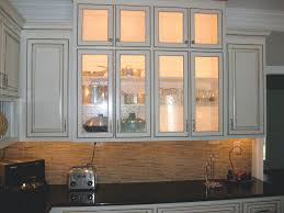 glass door kitchen cabinet lighting lighting can make a difference this custom kitchen