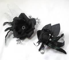 and black corsage and silver prom formal corsage and boutonniere set