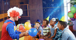 clowns for a birthday party clown giving high five to boy during birthday party at home 4k