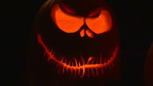 light up pumpkins for halloween stock video of a group of pumpkins lit up on halloween night 2303516