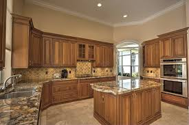 how to paint stained kitchen cabinets should you paint or stain your wooden kitchen cabinetry