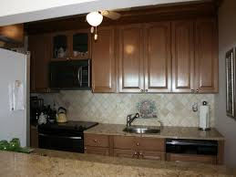 Easiest Way To Refinish Kitchen Cabinets Staining Kitchen Cabinets Home Design