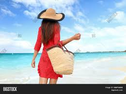 Tropical Clothes For Travel Woman Tourist Walking On Tropical Summer Vacation Wearing Sun Hat