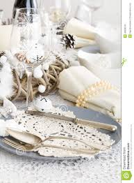 christmas table setting with traditional holiday decorations stock